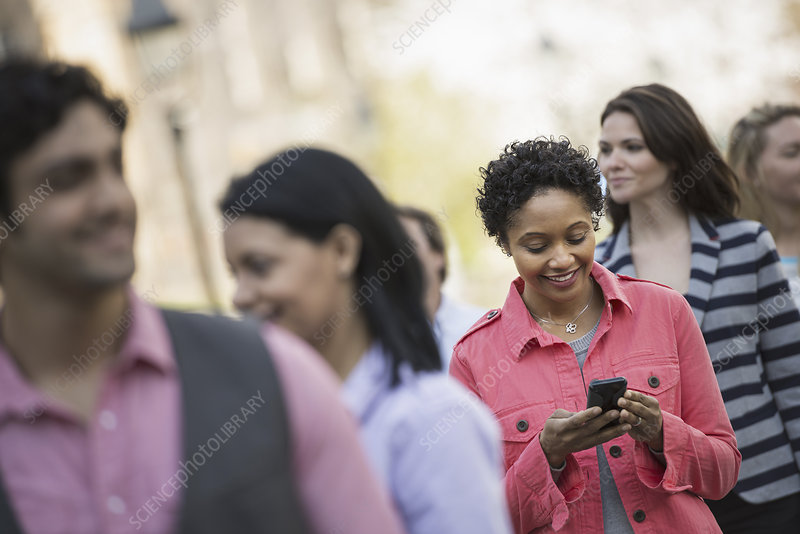 A woman checking her cell phone