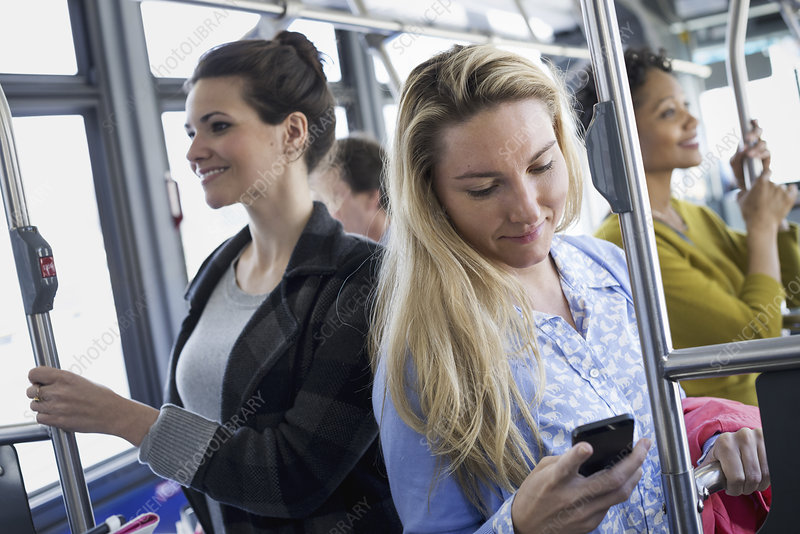 Woman on a bus using her phone