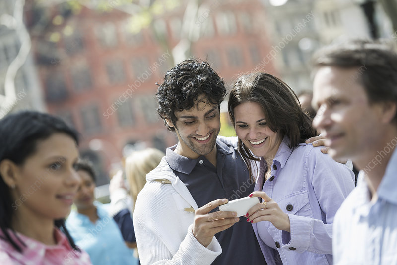 A couple looking at a cell phone