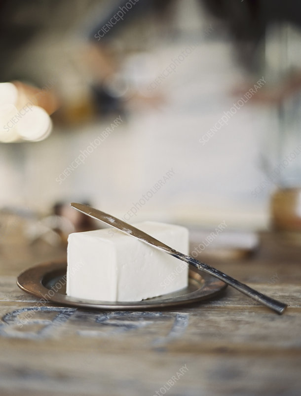 A slab of fresh organic butter on a dish