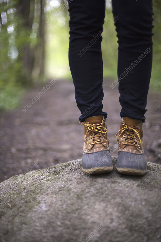 A woman wearing walking boots and jeans