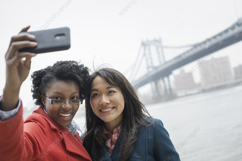 Two women taking a selfie of themselves