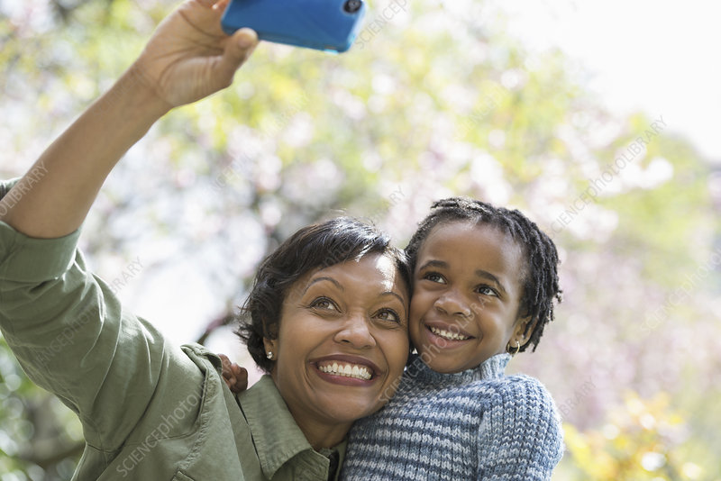 Mother and son taking picture with phone