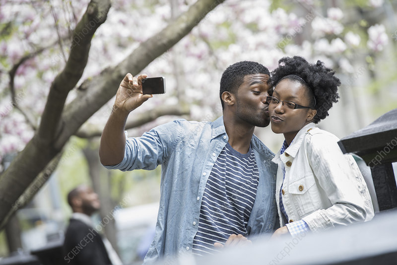 A man and woman taking a selfie
