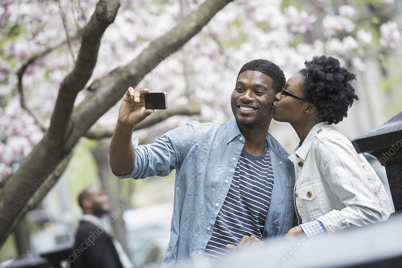A woman taking a selfie with smart phone