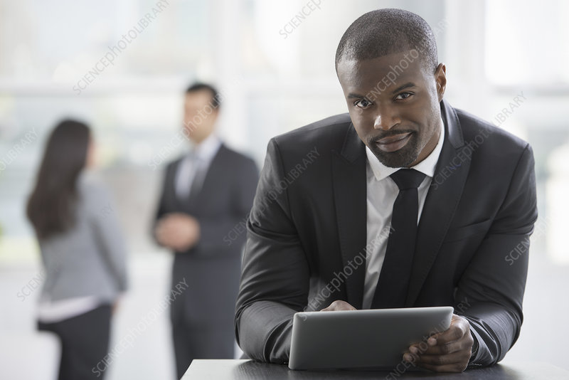 A man in suit using a digital tablet