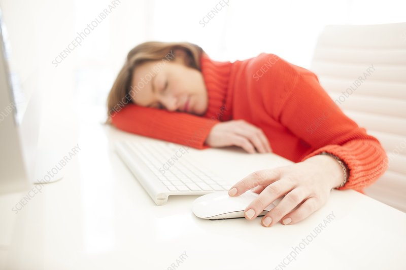 Woman asleep on keyboard