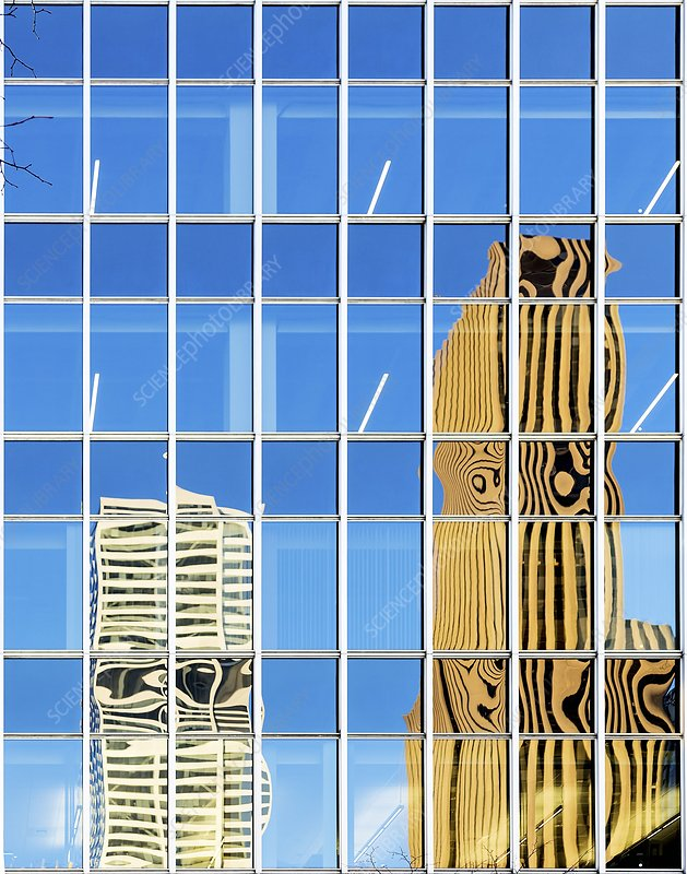 Buildings reflected in glass