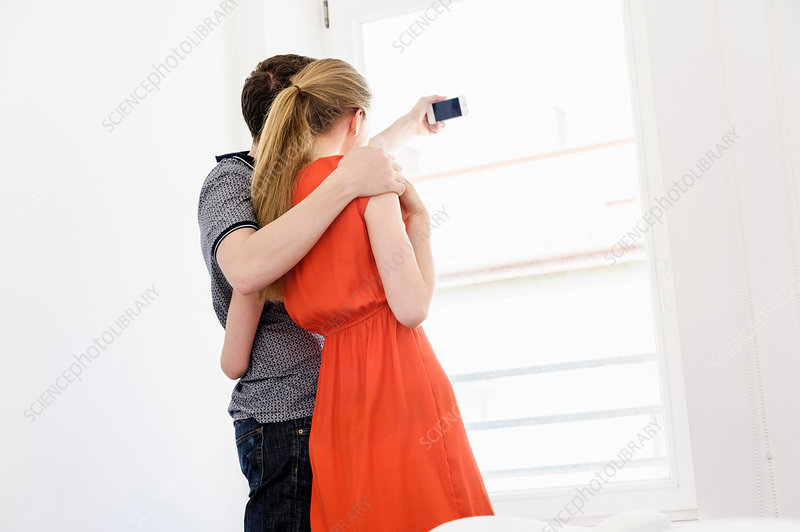 Young couple taking photograph