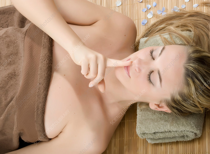 Woman at spa with finger on lips