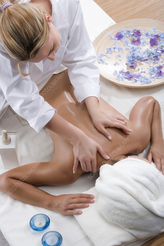 Person massaging woman's shoulders