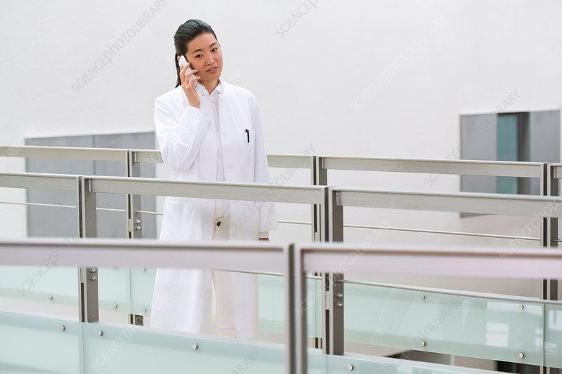 Scientist using mobile phone