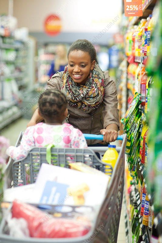 Female shopper with daughter in trolley