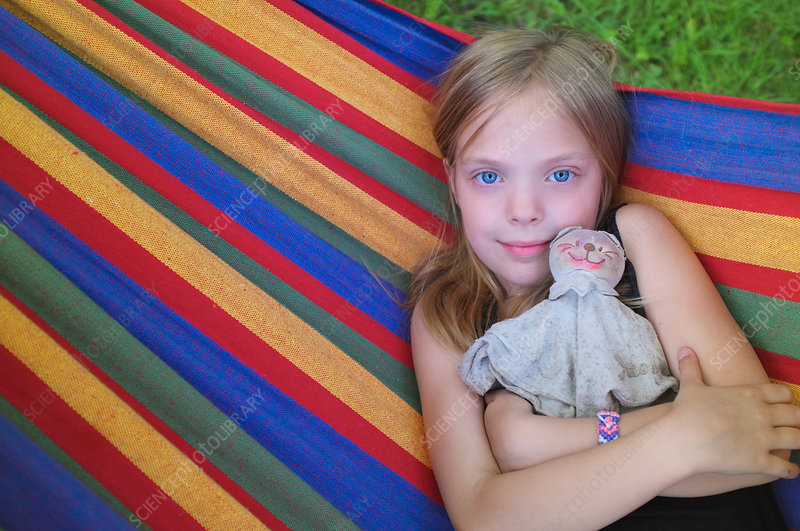 Portrait of young girl in hammock
