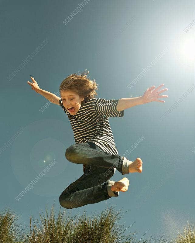 Teenage boy jumping