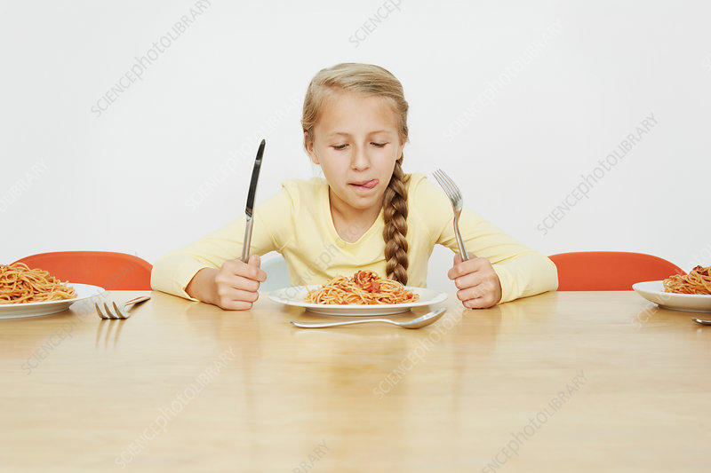 Girl with plate full of spaghetti