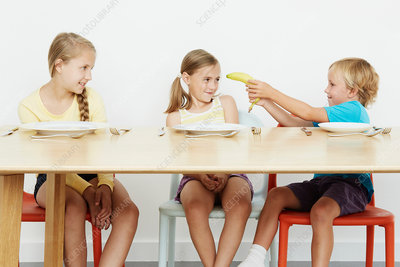 Three children at table