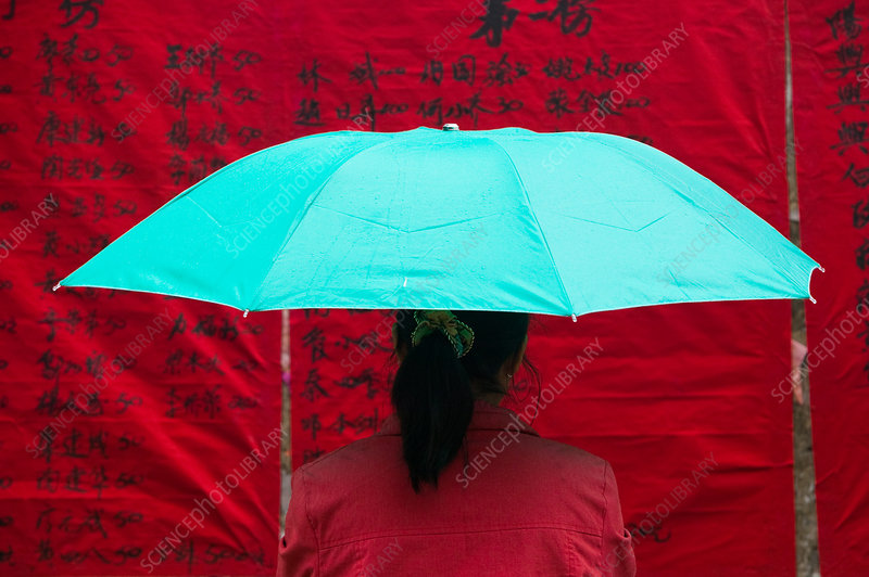 Woman under umbrella, China