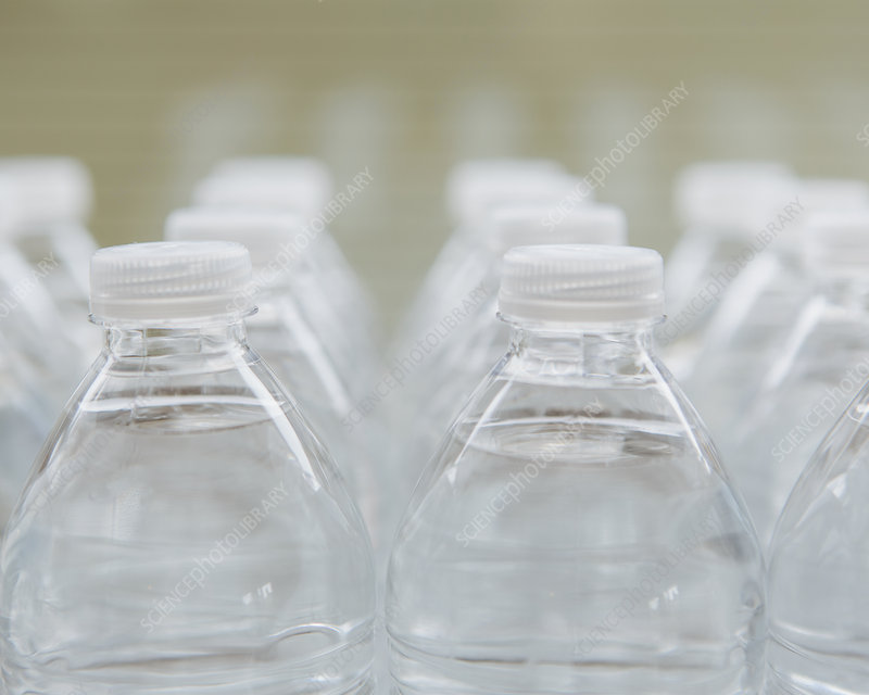 Rows of water-filled plastic bottles