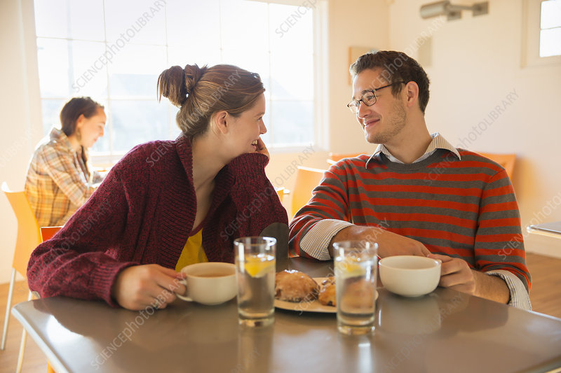 Man and a young woman in a coffee shop