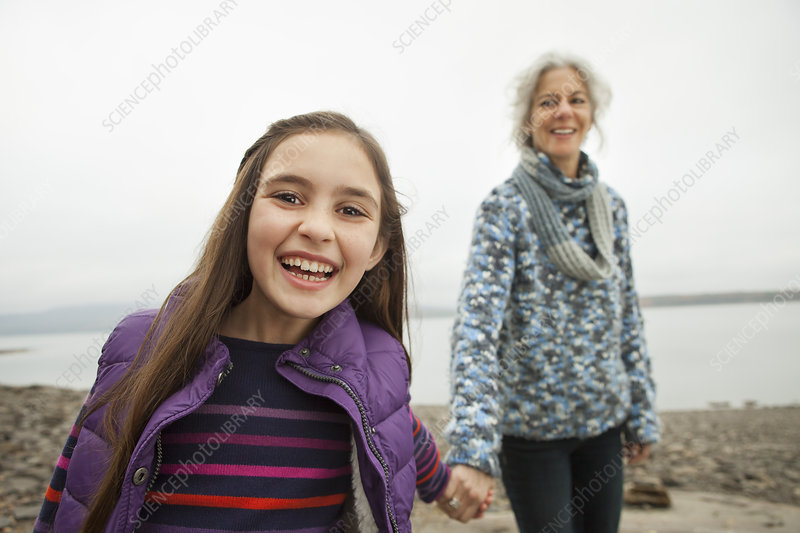 Woman holding hands with a young girl