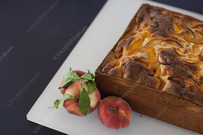 A square baked peach cake