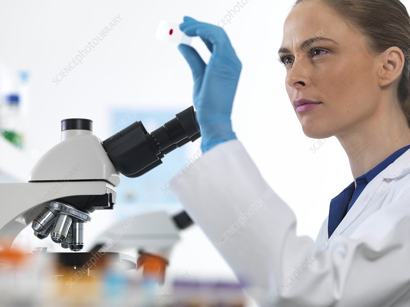 Scientist with microscope slide