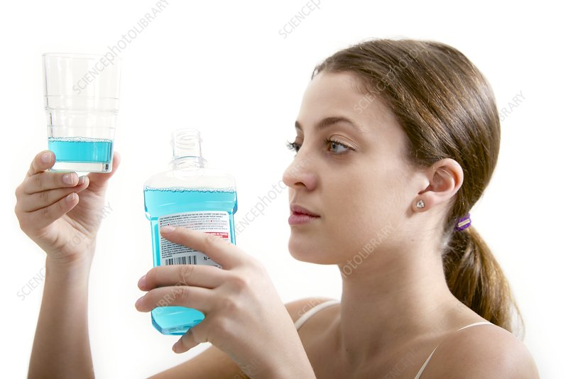 Teenage girl with mouthwash