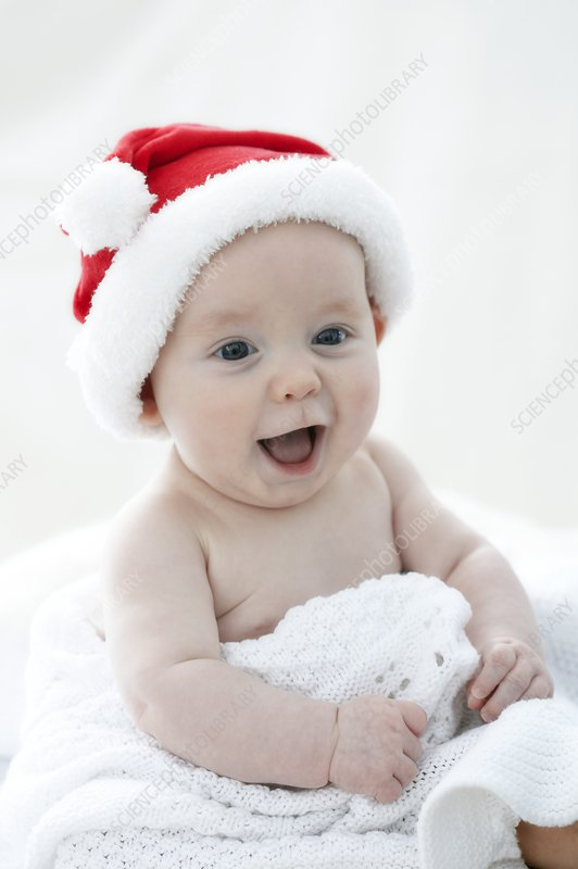 Baby boy wearing Santa hat