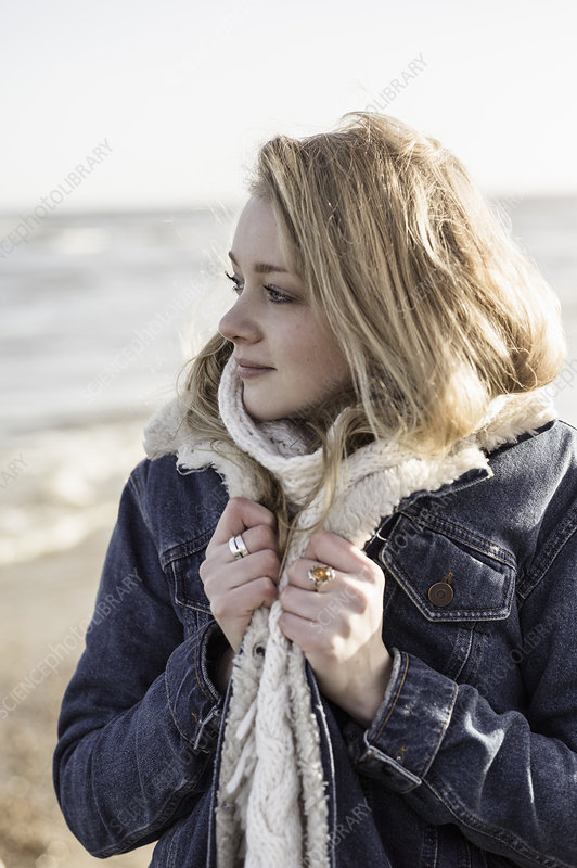 Girl on a beach in winter