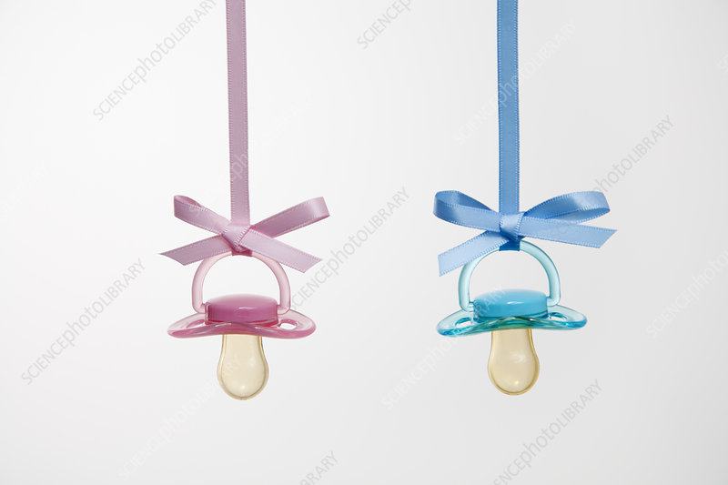 Baby pacifiers hanging from ribbons