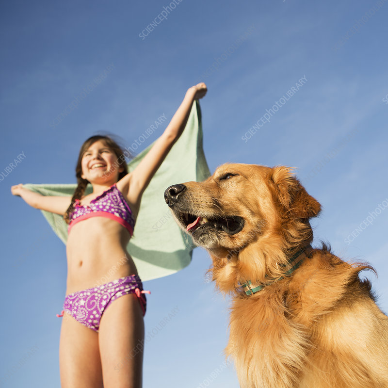 Girl with a golden retriever dog