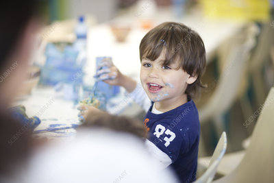 Toddler playing happily in art class
