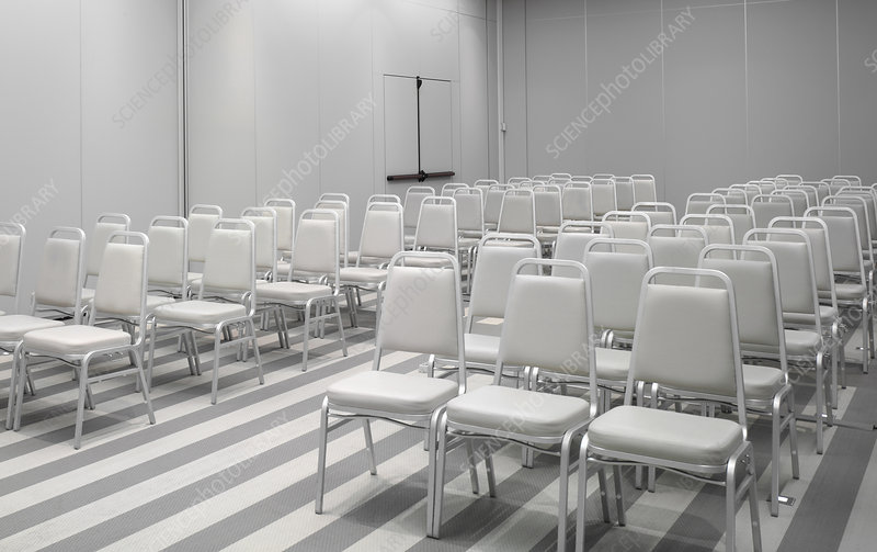 White chairs in empty auditorium