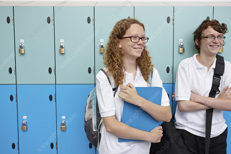 Teenagers next to school lockers