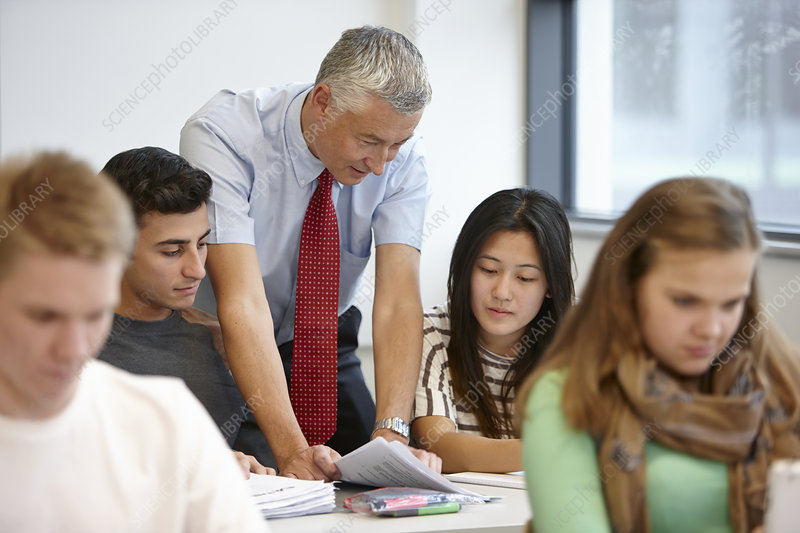 Teacher working with teenagers