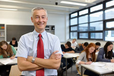 Mature male teacher in classroom