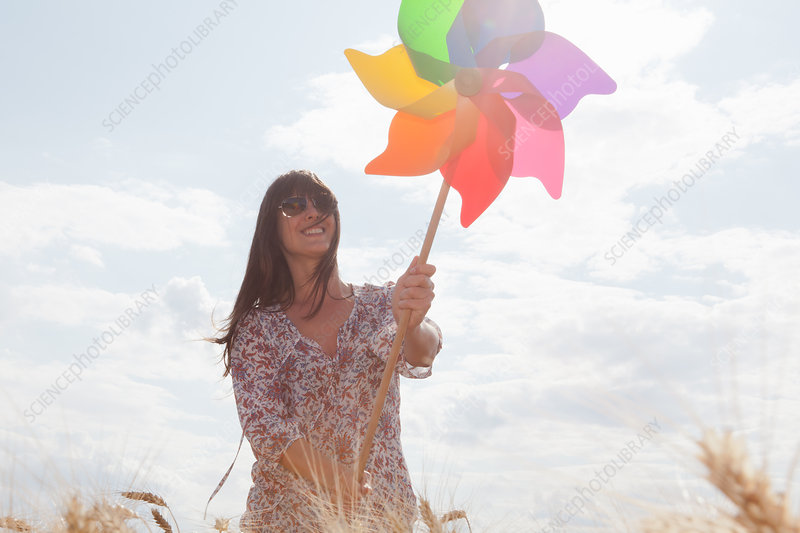 Mid adult woman holding windmill