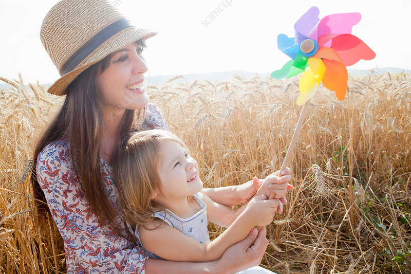 Mother and daughter in wheat field