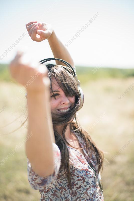 Woman dancing in field