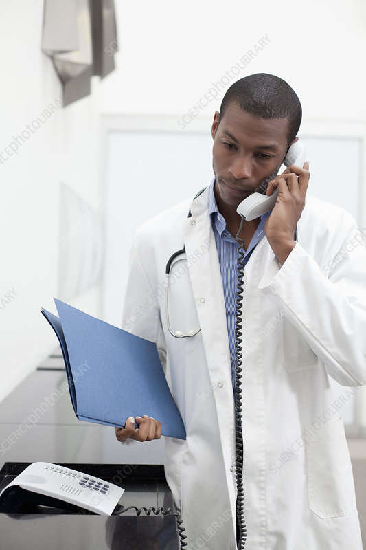 Doctor on telephone call