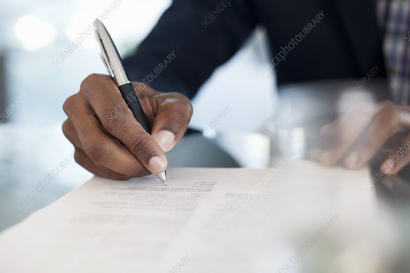 Businessman signing paperwork