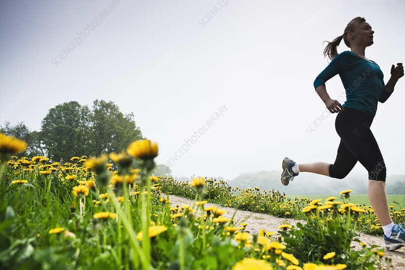 Mature woman running in countryside