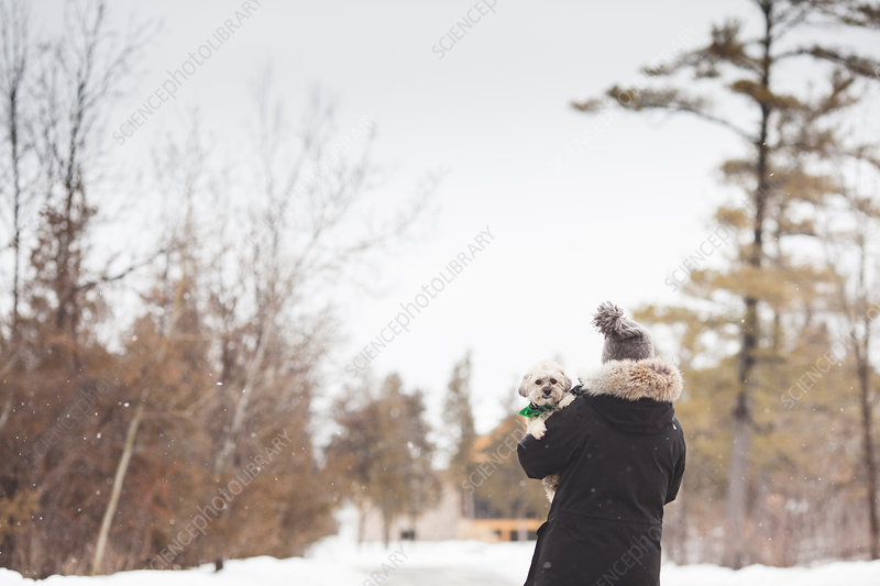 Woman with pet dog outdoors