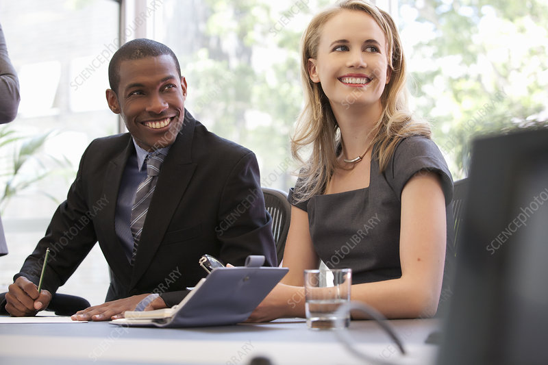 Business colleagues smiling at meeting