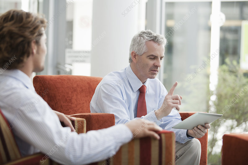 Businessmen brainstorming in office