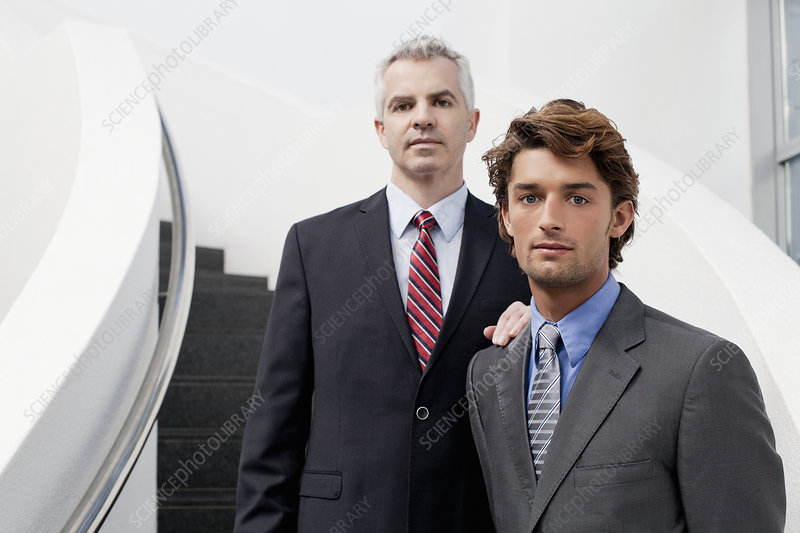 Businessmen on office stairs