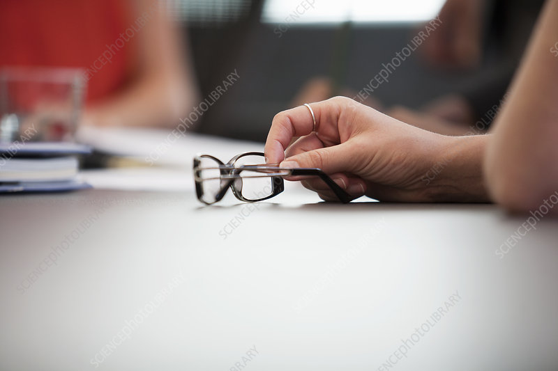 Hand and spectacles at meeting