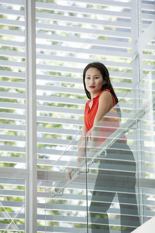 Young businesswoman on office balcony