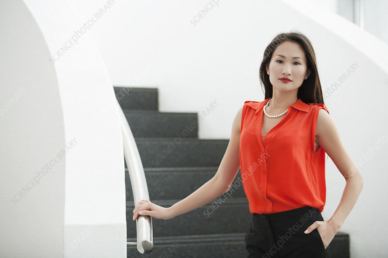 Young businesswoman on office stairs